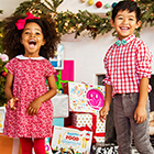 Children in front of many presents
