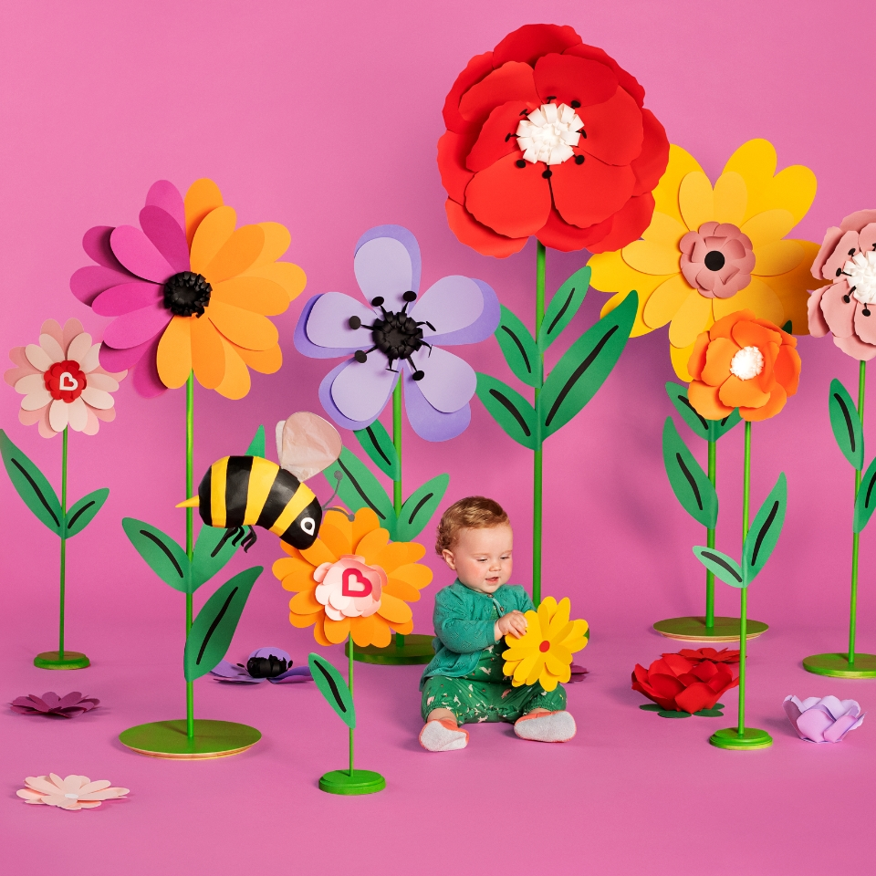 Kids sitting in flowers Cover Image